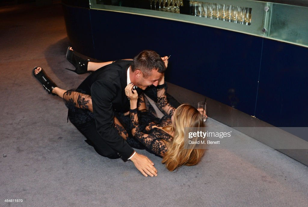 Jonathan Saunders (L) and Cara Delevingne attend the GQ Men Of The Year awards in association with Hugo Boss at The Royal Opera House on September 2, 2014 in London, England.