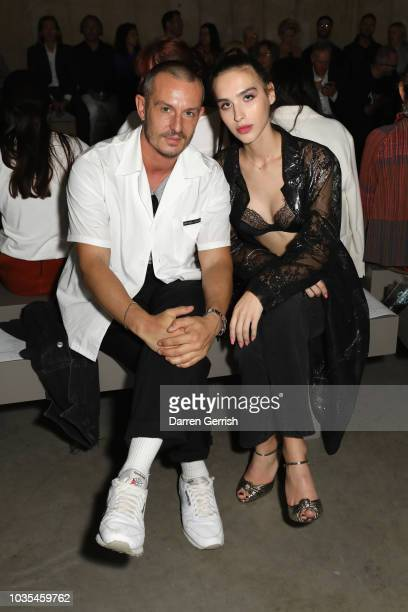 Jonathan Saunders and Maxim Magnus attend the Christopher Kane show during London Fashion Week September 2018 on September 17 2018 in London England