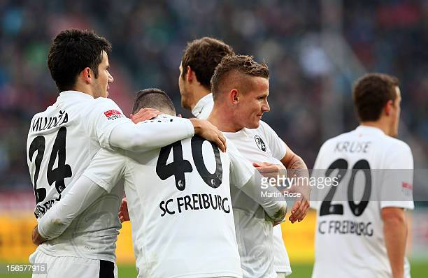 Jonathan Schmid Freiburg celebrate with his team mates after he scores his team's opening goal during the Bundesliga match between Hannover 96 and SC...