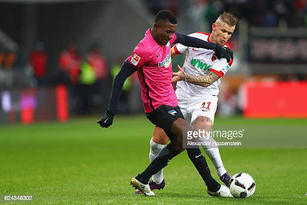 Jonathan Schmid of Augsburg battles for the ball with Salomon Kalou of Berlin during the Bundesliga match between FC Augsburg and Hertha BSC at WWK...