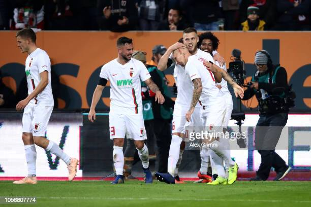 Jonathan Schmid of Augsburg celebrates after scoring his team's second goal with his team mates during the Bundesliga match between FC Augsburg and 1...
