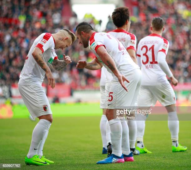 Jonathan Schmid of Augsburg celebrates scoring his goal with Ral Bobadilla during the Bundesliga match between FC Augsburg and Werder Bremen at WWK...