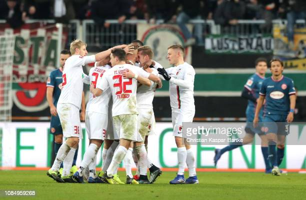 Jonathan Schmid of Augsburg celebrates with teammates after scoring his sides first goal during the Bundesliga match between FC Augsburg and Fortuna...