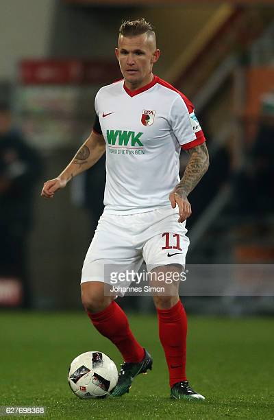 Jonathan Schmid of Augsburg in action during the Bundesliga match between FC Augsburg and Eintracht Frankfurt at WWK Arena on December 4 2016 in...