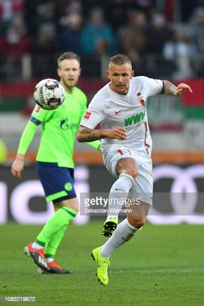 Jonathan Schmid of Augsburg plays the ball during the Bundesliga match between FC Augsburg and FC Schalke 04 at WWKArena on December 15 2018 in...