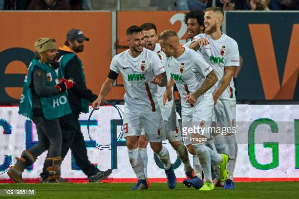 Jonathan Schmid of FC Augsburg celebrates after scoring his team's second goal with team mates during the Bundesliga match between FC Augsburg and 1....