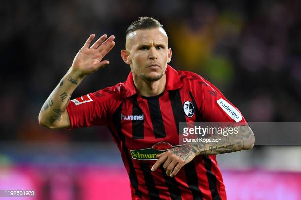 Jonathan Schmid of Sport-Club Freiburg celebrates after scoring his team's first goal during the Bundesliga match between Sport-Club Freiburg and VfL...