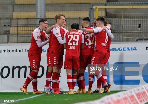 Jonathan Schmid of Sport-Club Freiburg celebrates with teammates after scoring his team's second goal during the Bundesliga match between Sport-Club...