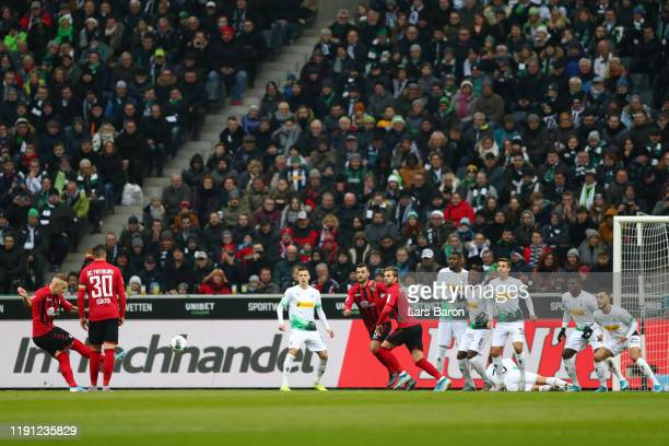 Jonathan Schmid of Sport-Club Freiburg scores his sides first goal during the Bundesliga match between Borussia Moenchengladbach and Sport-Club...