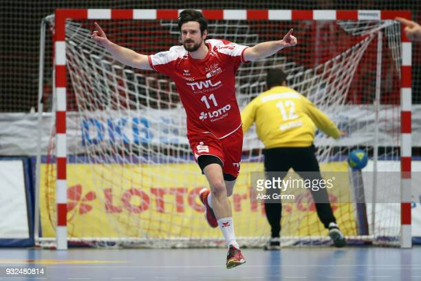 Jonathan Scholz of Ludwigshafen celebrates a goal during the DKB HBL match between Die Eulen Ludwigshafen and HSG Wetzlar at FriedrichEbertHalle on...