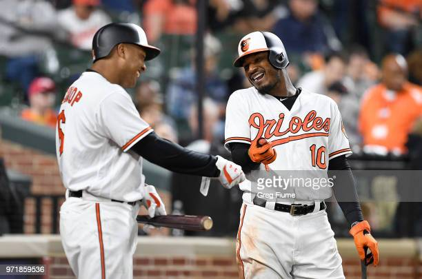 Jonathan Schoop and Adam Jones of the Baltimore Orioles talk during a pitching change in the seventh inning against the Boston Red Sox at Oriole Park...