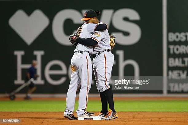 Jonathan Schoop and JJ Hardy of the Baltimore Orioles embrace after a victory over the Boston Red Sox at Fenway Park on September 13 2016 in Boston...