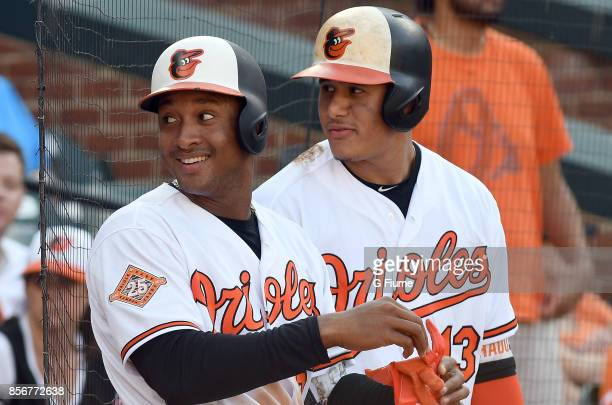 Jonathan Schoop and Manny Machado of the Baltimore Orioles wait to bat during the game against the Tampa Bay Rays at Oriole Park at Camden Yards on...