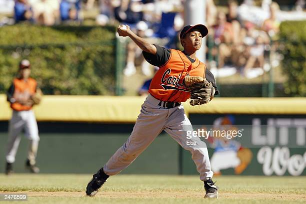 Jonathan Schoop of Curacao throws the ball to first for the out against Japan during the Little League World Series on August 23 2003 at Lamade...