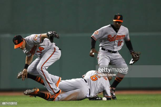 Jonathan Schoop of the Baltimore Orioles and Craig Gentry of the Baltimore Orioles collide attempting to collect a single hit by Christian Vazquez of...