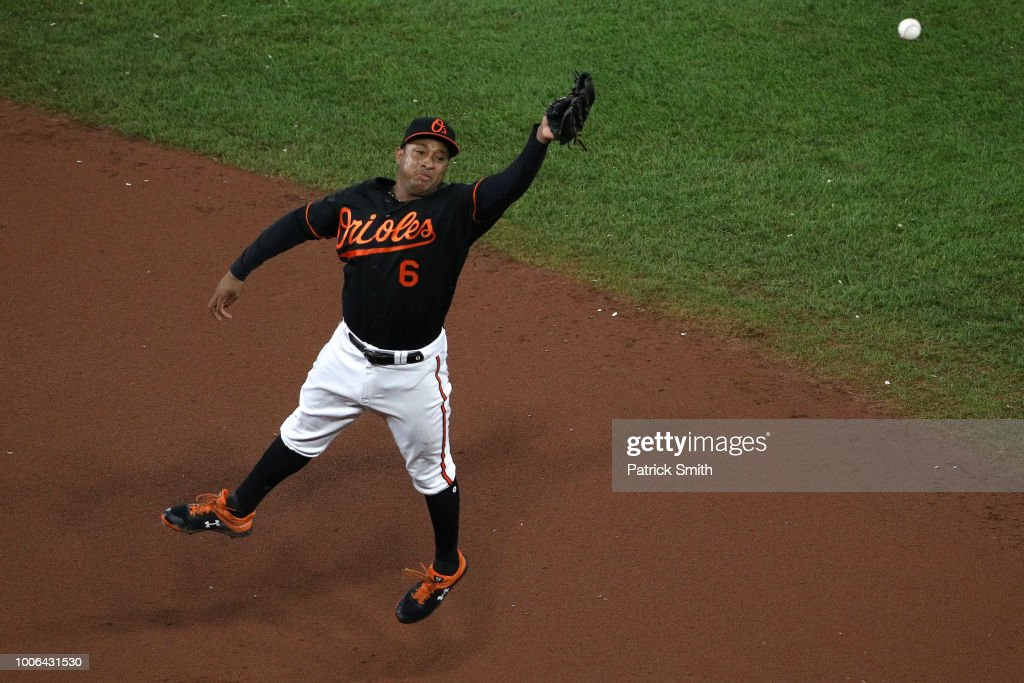 Jonathan Schoop #6 of the Baltimore Orioles cannot make a catch against the Tampa Bay Rays during the seventh inning at Oriole Park at Camden Yards on July 27, 2018 in Baltimore, Maryland.