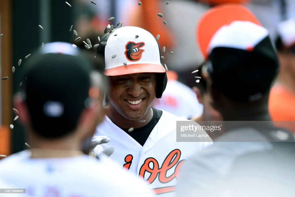 Jonathan Schoop #6 of the Baltimore Orioles celebrates a three run home run in the seventh inning with teammates during a baseball game against the Tampa Bay Rays at Oriole Park at Camden Yards on July 29, 2018 in Baltimore, Maryland.