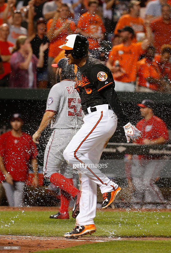 Jonathan Schoop #6 of the Baltimore Orioles celebrates after hitting a walk off home run from pitcher Tanner Roark #57 of the Washington Nationals in the ninth inning to give the Orioles a 3-2 win over the Washington Nationals at Oriole Park at Camden Yards on July 10, 2015 in Baltimore, Maryland.