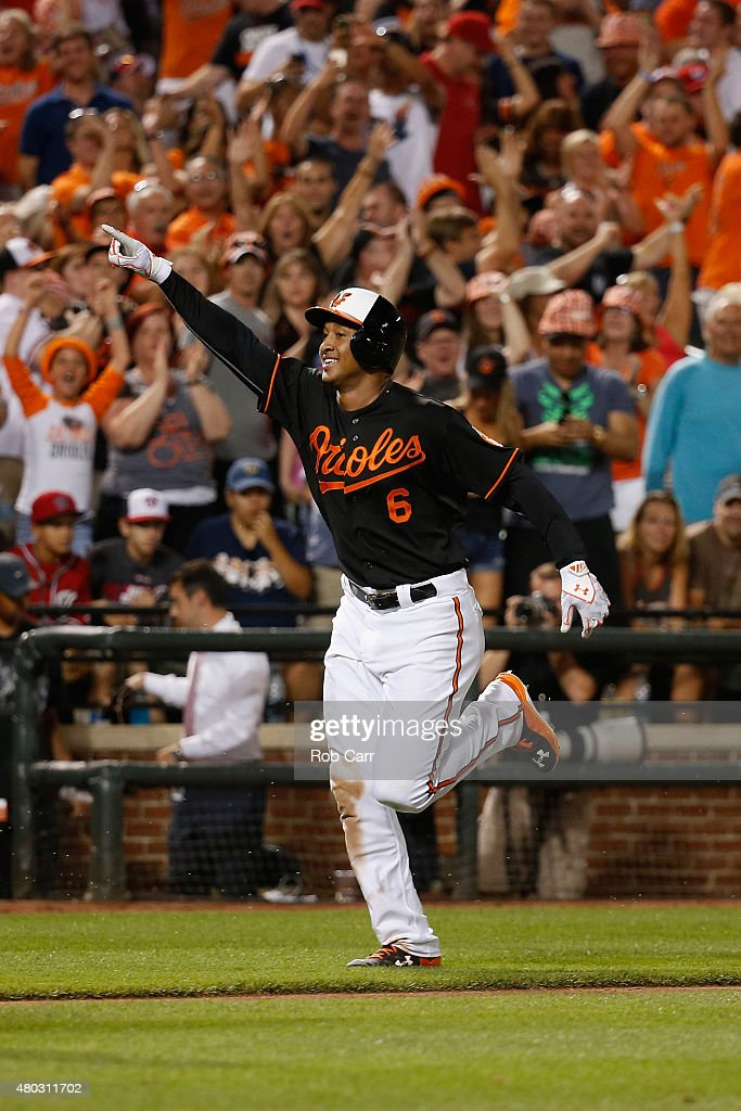 Jonathan Schoop #6 of the Baltimore Orioles celebrates rounding the bases after hitting a walk off home run in the ninth inning to give the Orioles a 3-2 win over the Washington Nationals at Oriole Park at Camden Yards on July 10, 2015 in Baltimore, Maryland.
