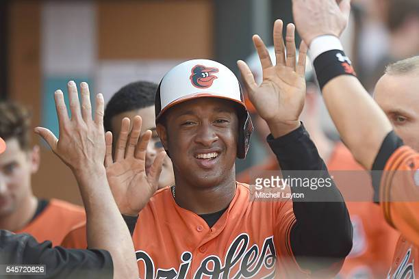 Jonathan Schoop of the Baltimore Orioles celebrates scoring on Joe Smith of the Los Angeles Angels of Anaheim balk in the seventh inning during a...
