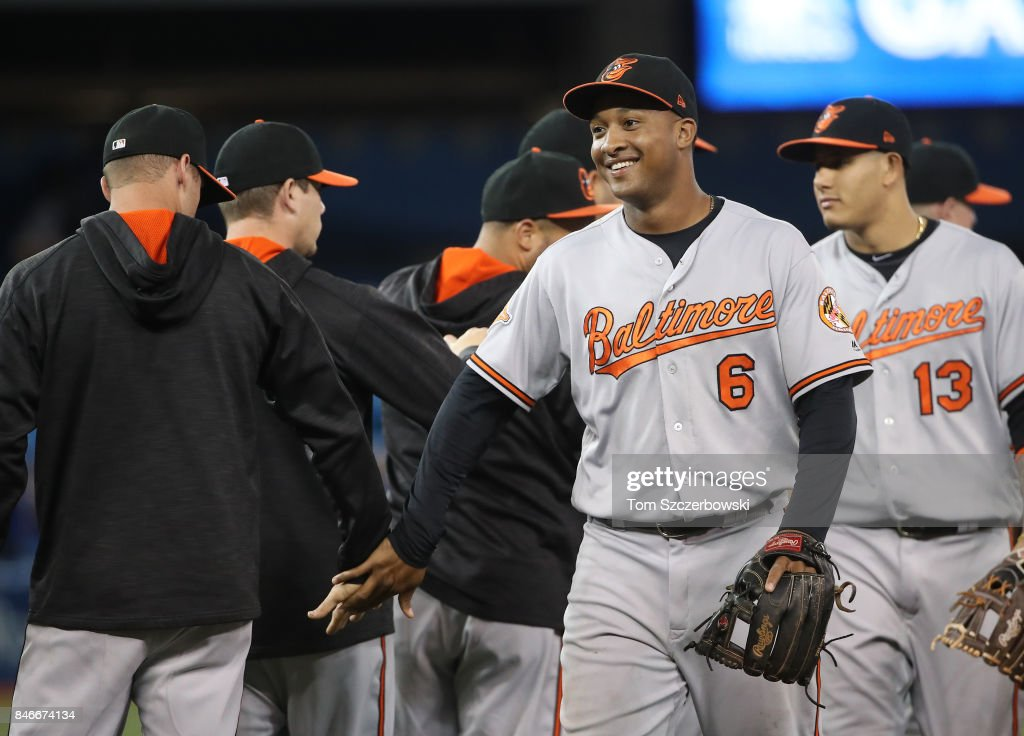 Jonathan Schoop #6 of the Baltimore Orioles celebrates their victory with teammates during MLB game action against the Toronto Blue Jays at Rogers Centre on September 13, 2017 in Toronto, Canada.
