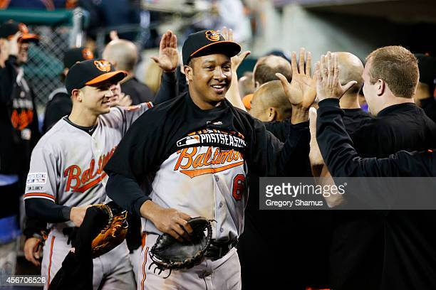Jonathan Schoop of the Baltimore Orioles celebrates with teammates after their 2 to 1 win over the Detroit Tigers to sweep the series in Game Three...