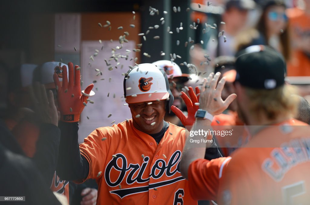 Jonathan Schoop #6 of the Baltimore Orioles celebrates with teammates after hitting a home run in the third inning against the Tampa Bay Rays during the first game of a doubleheader at Oriole Park at Camden Yards on May 12, 2018 in Baltimore, Maryland.