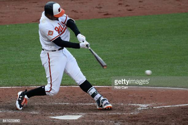Jonathan Schoop of the Baltimore Orioles drives in the go ahead run against the Seattle Mariners in the eighth inning of the Orioles 87 win at Oriole...