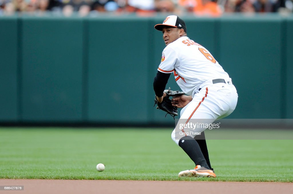 Jonathan Schoop #6 of the Baltimore Orioles drops the ball for a error in the first inning against the Toronto Blue Jays at Oriole Park at Camden Yards on May 21, 2017 in Baltimore, Maryland.