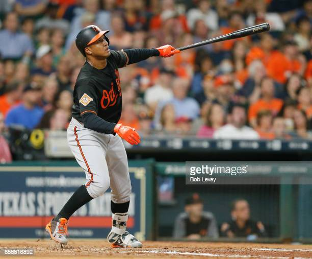 Jonathan Schoop of the Baltimore Orioles hits a double to right field in the third inning against the Houston Astros at Minute Maid Park on May 26...