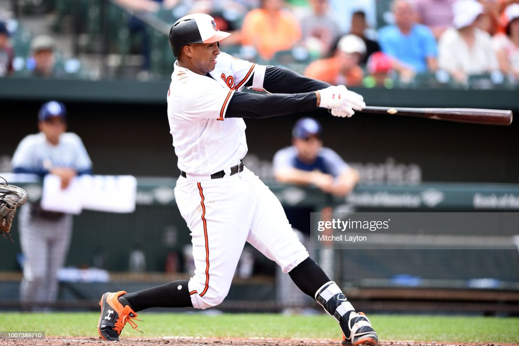 Jonathan Schoop #6 of the Baltimore Orioles hits a three run home run in the seventh inning during a baseball game against the Tampa Bay Rays at Oriole Park at Camden Yards on July 29, 2018 in Baltimore, Maryland.