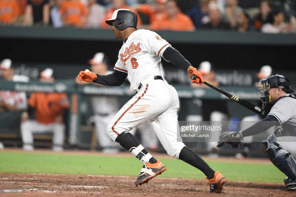 Jonathan Schoop #6 of the Baltimore Orioles hits a walk off hit in the ninth inning during a baseball game against the New York Yankees at Oriole Park at Camden Yards on July 10, 2018 in Baltimore, Maryland.