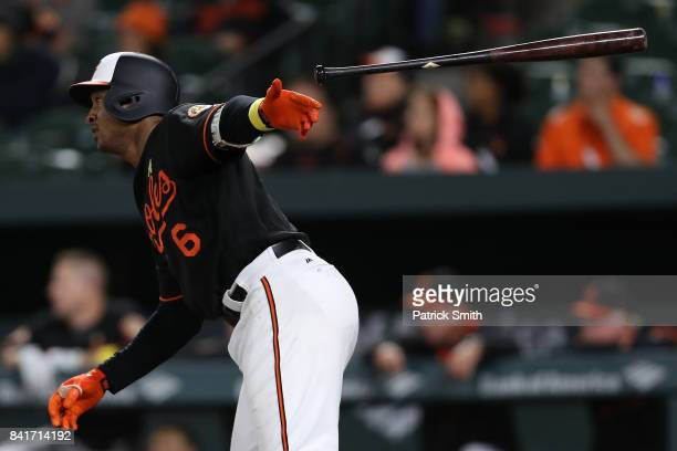 Jonathan Schoop of the Baltimore Orioles hits an RBI double against the Toronto Blue Jays during the thirteenth inning to win the game at Oriole Park...