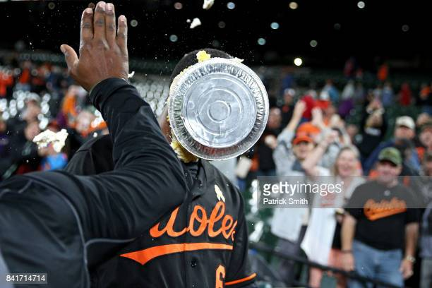 Jonathan Schoop of the Baltimore Orioles is pied by teammate Adam Jones during a post game interview after hitting an RBI double against the Toronto...