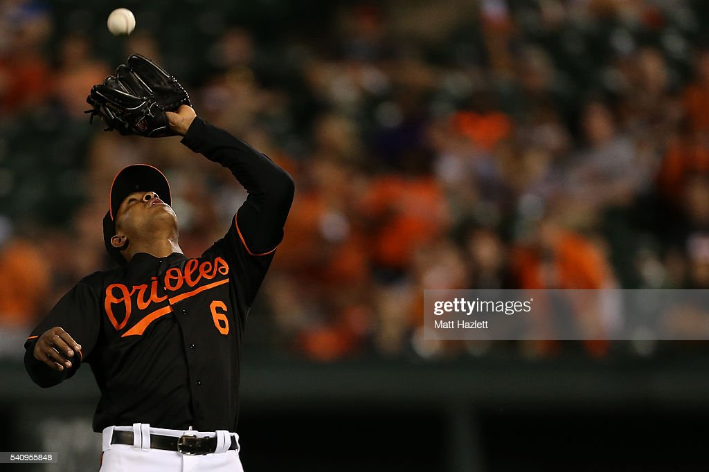 Jonathan Schoop #6 of the Baltimore Orioles makes a catch for the second out of the ninth inning against the Toronto Blue Jays at Oriole Park at Camden Yards on June 17, 2016 in Baltimore, Maryland.