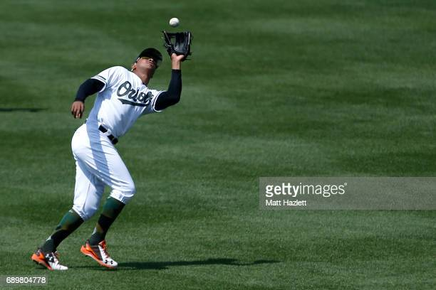 Jonathan Schoop of the Baltimore Orioles makes a catch off of the bat of Starlin Castro of the New York Yankees for the third out of the sixth inning...