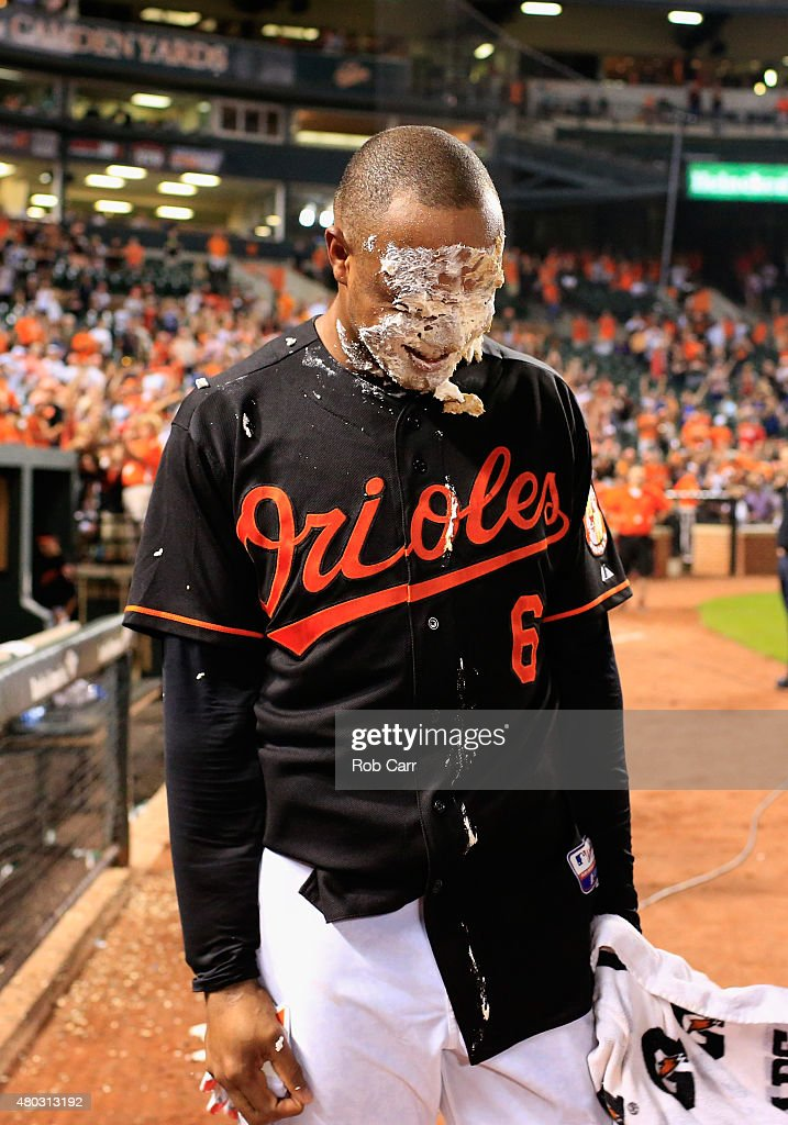 Jonathan Schoop #6 of the Baltimore Orioles reacts after getting hit with a pie after hitting a walk off home run giving the Orioles a 3-2 win over the Washington Nationals at Oriole Park at Camden Yards on July 10, 2015 in Baltimore, Maryland.