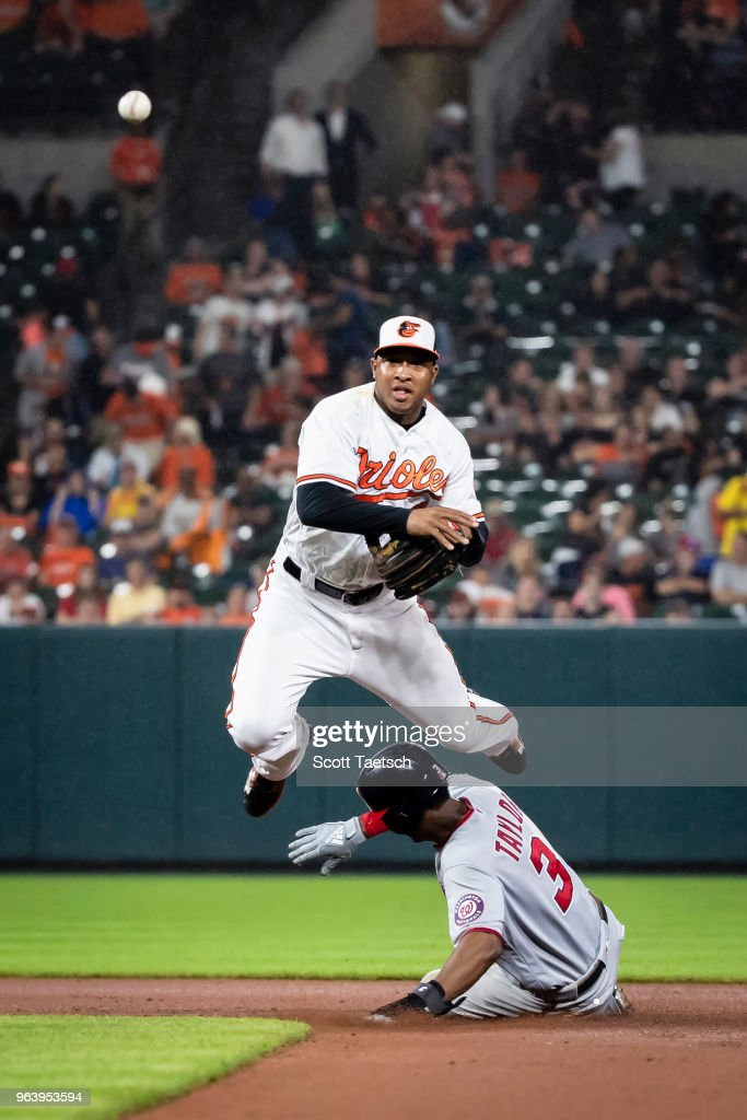 Jonathan Schoop #6 of the Baltimore Orioles retires Michael Taylor #3 of the Washington Nationals at second base during the seventh inning at Oriole Park at Camden Yards on May 30, 2018 in Baltimore, Maryland.
