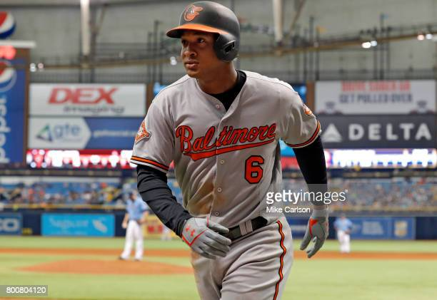 Jonathan Schoop of the Baltimore Orioles returns to the dugout after hitting a home run during the eighth inning of a game against the Tampa Bay Rays...