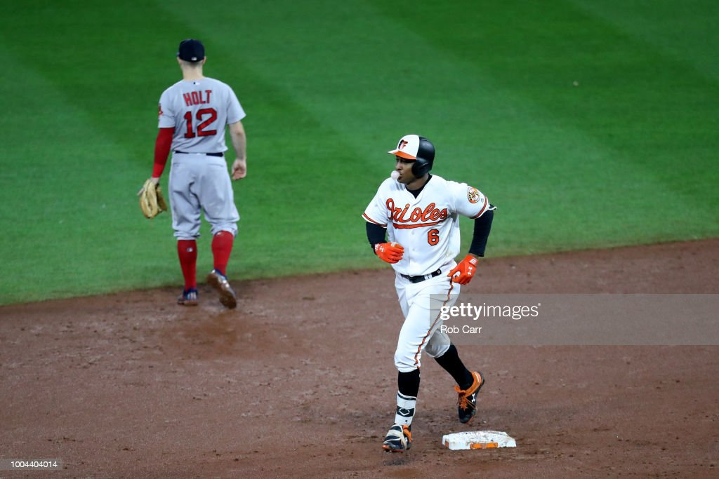 Jonathan Schoop #6 of the Baltimore Orioles rounds the bases after hitting a two RBI home run against the Boston Red Sox in the eighth inning at Oriole Park at Camden Yards on July 23, 2018 in Baltimore, Maryland.