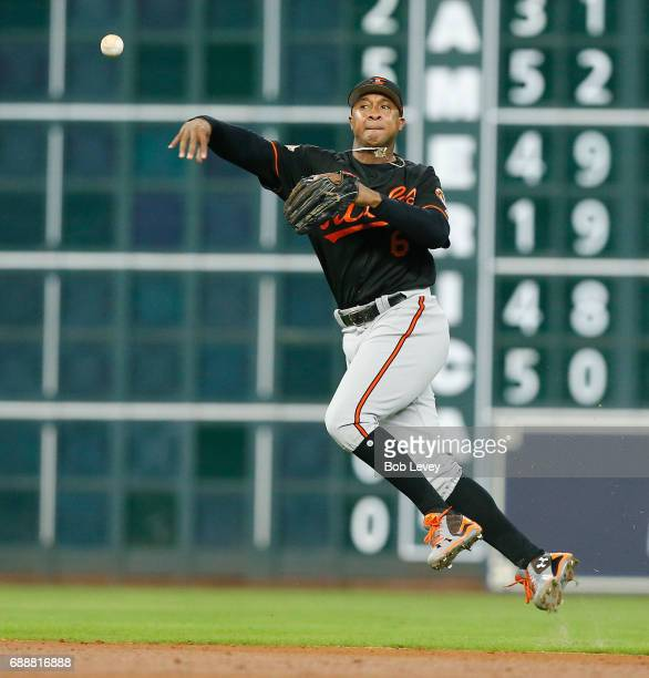 Jonathan Schoop of the Baltimore Orioles throws from behind second base but unable to throw out Carlos Correa of the Houston Astros in the second...