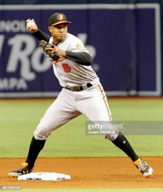 Jonathan Schoop of the Baltimore Orioles throws the ball to first to complete a double play during the game against the Tampa Bay Rays at Tropicana...