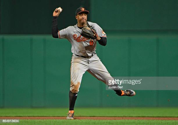 Jonathan Schoop of the Baltimore Orioles throws to first base for a force out of Adam Frazier of the Pittsburgh Pirates in the seventh inning during...