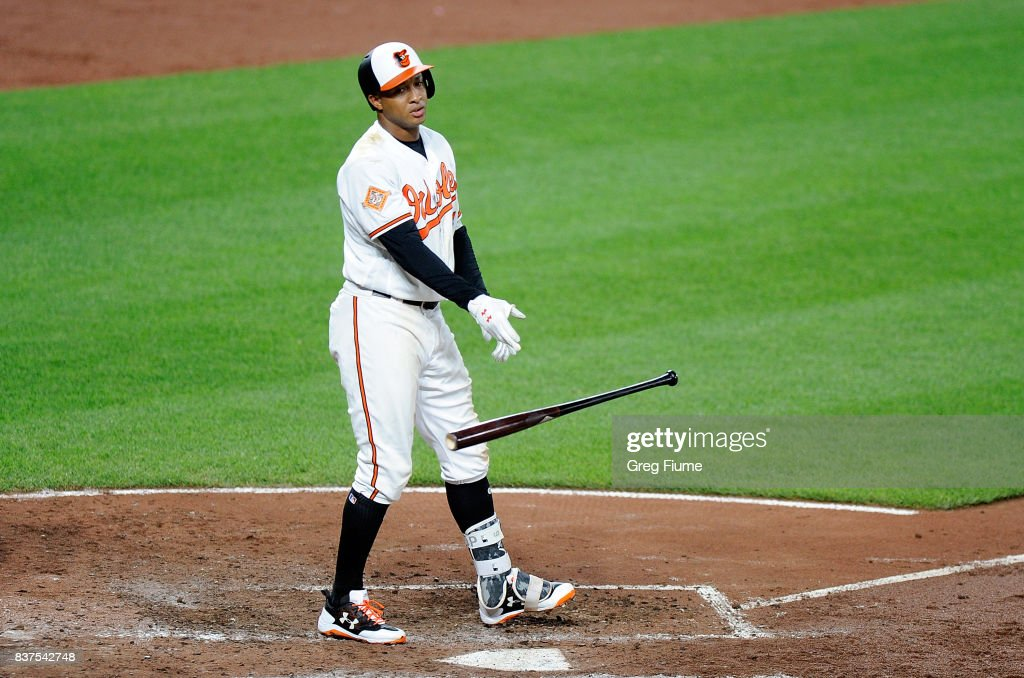 Jonathan Schoop #6 of the Baltimore Orioles tosses his bat after striking out to end the sixth inning against the Oakland Athletics at Oriole Park at Camden Yards on August 22, 2017 in Baltimore, Maryland.