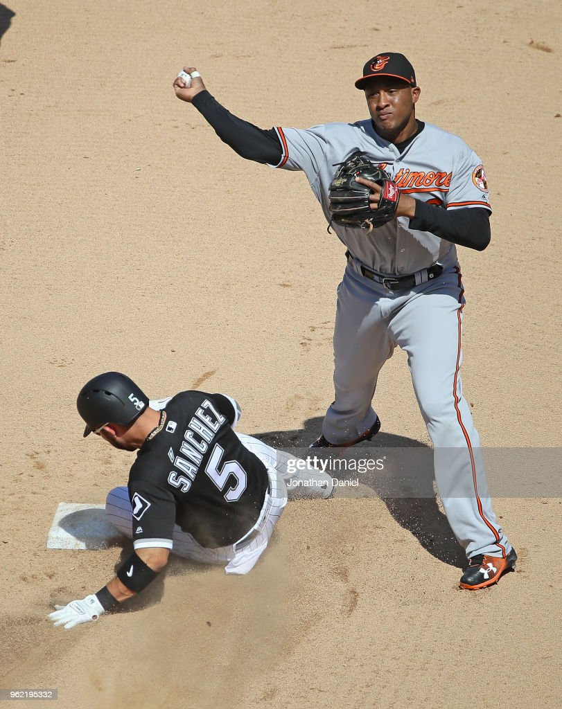 Jonathan Schoop #6 of the Baltimore Orioles turns a double play over Yolmer Sanchez #5 of the Chicago White Sox in the 6th inning at Guaranteed Rate Field on May 24, 2018 in Chicago, Illinois. The Orioles defeated the White Sox 9-3.