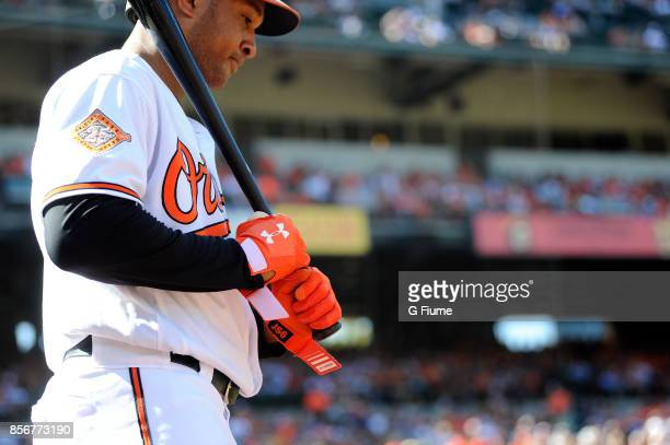 Jonathan Schoop of the Baltimore Orioles wears Under Armour batting gloves during the game against the Tampa Bay Rays at Oriole Park at Camden Yards...