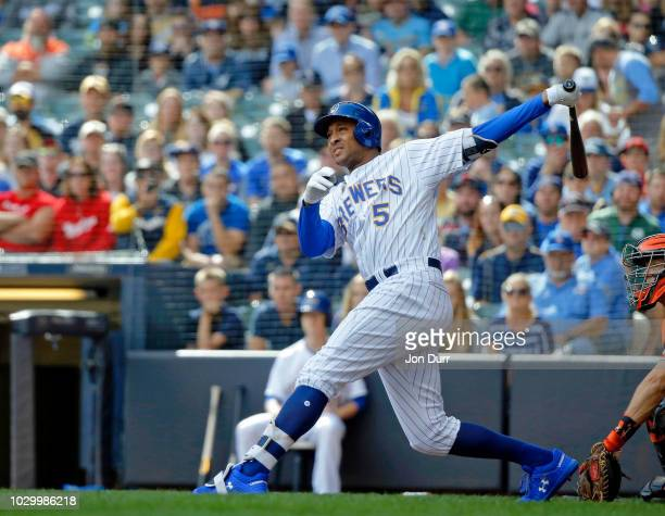Jonathan Schoop of the Milwaukee Brewers hits a grand slam against the San Francisco Giants during the sixth inning at Miller Park on September 9...
