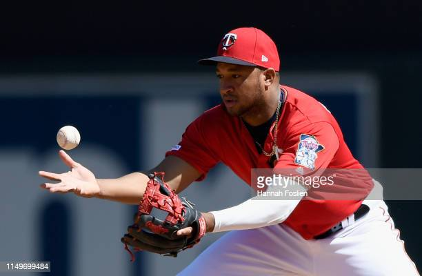 Jonathan Schoop of the Minnesota Twins bobbles the ball at second base during the eighth inning of the game against the Seattle Mariners on June 13...