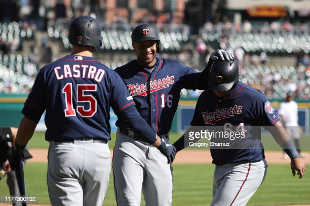 Jonathan Schoop of the Minnesota Twins celebrates his seventh inning two run home run with Willians Astudillo and Jason Castro while playing the...