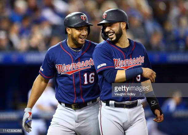 Jonathan Schoop of the Minnesota Twins celebrates with Marwin Gonzalez after hitting a tworun home run in the third inning during a MLB game against...